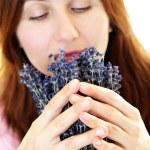 Woman smelling lavender — Stock Photo