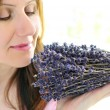 Woman smelling lavender — Stock Photo