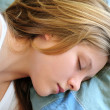 Teenage girl sleeping - Stock Photo