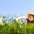 Stock Photo: Young girl laying in meadow