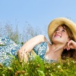 Young girl laying in meadow — Stock Photo