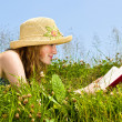 Young girl reading book in meadow — Stock Photo #4718859