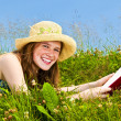 Young girl reading book in meadow — Stock Photo #4718860