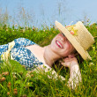 Stock Photo: Young girl laying on meadow