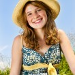 Young girl sitting in meadow — Stock Photo #4718876
