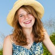 Portrait of young girl smiling in meadow — Stock Photo #4718877