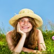 Young girl laying in meadow — Stock Photo #4718879