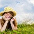 Young girl laying in meadow - Stock Photo
