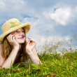 Young girl laying in meadow — Stock Photo #4718885