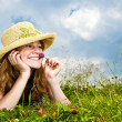 Young girl laying in meadow — Stock Photo #4718886