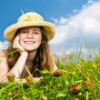 Young girl laying in meadow — Stock Photo #4718889