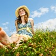 Young barefoot girl sitting in meadow — Stock Photo #4718892