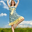 Young girl dancing in meadow — Stock Photo #4718893