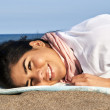 Young native american woman at beach — Stock Photo
