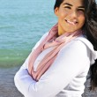 Beautiful young woman at beach - Stock Photo