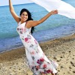 Beautiful young woman at beach with white scarf — Stock Photo #4718998
