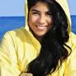 Beautiful young woman in raincoat — Stockfoto