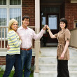 Stock Photo: Happy couple with real estate agent