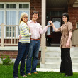 Happy couple with real estate agent — Stockfoto