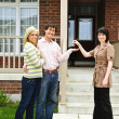 Happy couple with real estate agent — Stock Photo #4719055