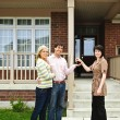 Happy couple with real estate agent — Stock Photo #4719056