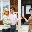 Happy couple with real estate agent — Stock Photo