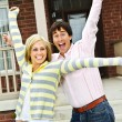 Excited couple at home - Stockfoto
