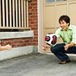 Father and son playing soccer - Stock Photo