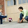 Father and son playing soccer — Стоковое фото