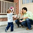 Family playing with soccer ball - Stock Photo