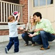 Family playing with soccer ball - Stockfoto