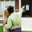 Happy couple in front of home — Stock Photo #4719081