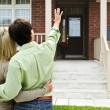 Happy couple in front of home — Stock Photo