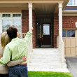 Happy couple in front of home — Stock Photo #4719084