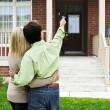 Happy couple in front of home — Foto de Stock