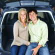 Couple sitting in back of car — Stock Photo #4719092