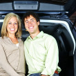 Stock Photo: Couple sitting in back of car