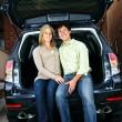 Couple sitting in back of car - Stock Photo