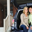 Couple sitting in back of car — Stock Photo