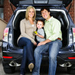 Couple sitting in back of car — Stock Photo #4719097