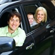 Happy family in car — Stock Photo