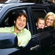 Stock Photo: Happy family in car