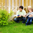 Family watering plant - Stock Photo