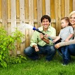 Family watering plant — Stock Photo #4719102