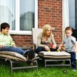 Happy family relaxing at home — Stock Photo #4719113