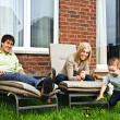 Stock Photo: Happy family relaxing at home