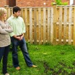 Couple concerned about lawn - Stockfoto
