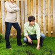 Couple concerned about lawn - Foto Stock