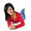Young woman smiling laying down — Stock Photo