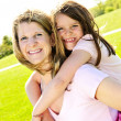 Mother and daughter piggyback — Stock Photo #4719271